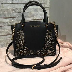 Black Michael Kors handbag with gold studs